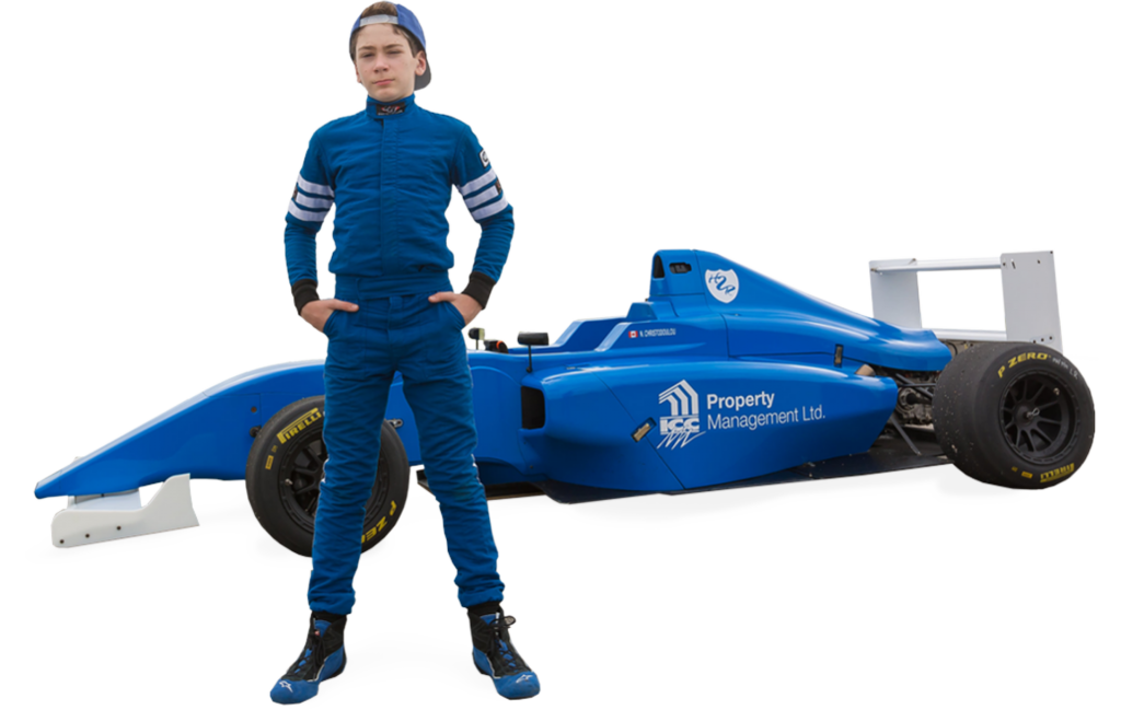Nico Christodoulou image in front of race car
